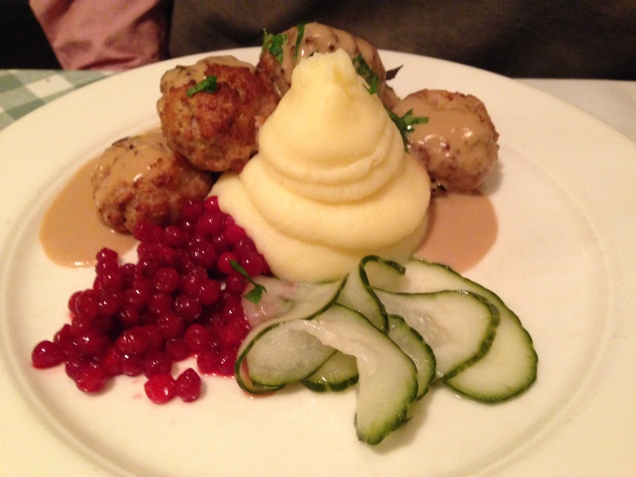 Meatballs with mashed potato, lingonberries and cucumber