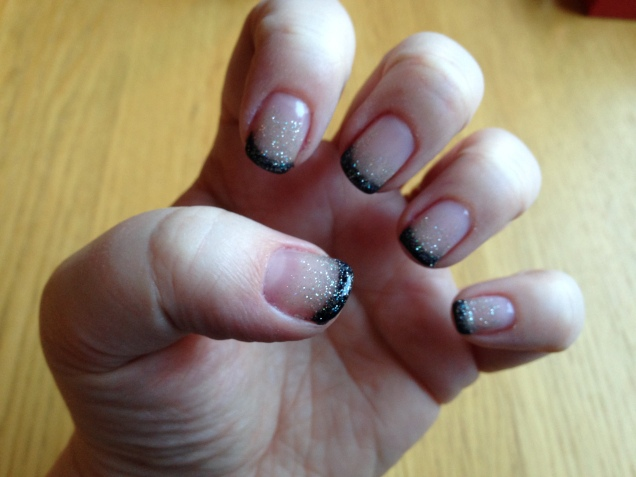 Black and glitter French nails.
