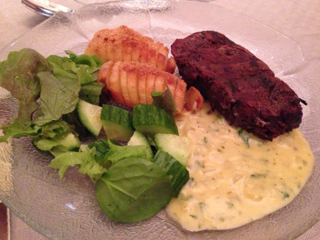 Grilled beef tenderloin with home made Bernaise sauce and potato.