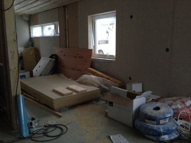 Part of the kitchen and the extra bedroom downstairs. The wall will almost in the middle of the two window sets.