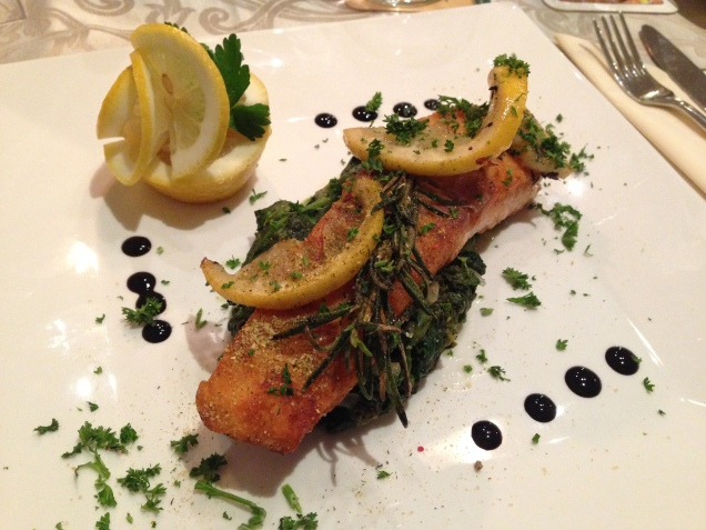 The hotel offered very taste food! Here it's salmon on a bed of spinach.