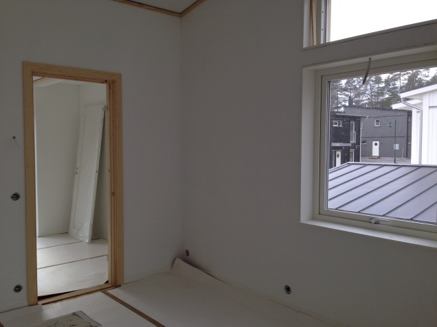 The trim around the windows and doors as well as the baseboards are up, but some still awaiting some paint.