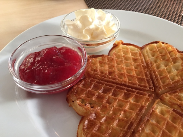 Yummy lunch! Waffles with strawberry jam and whipped cream.